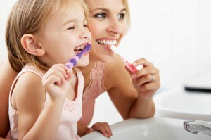 Motivating Brush kids brushing teeth with parents